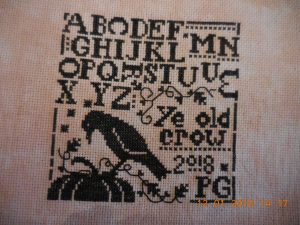 ye old crow sampler stitched piece.