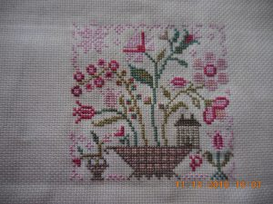 Fairy Garden by Blackbird Designs stitched piece.