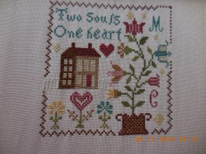 Hearts in Bloom Stitched piece.