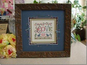 A Little Love framed by Jill Rensel.