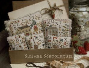 Summer Schoolhouse Entire Series - An old fashioned school box houses the collection.